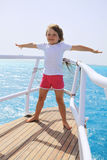 A little girl standing at the stern of the ship Stock Photos