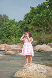 Little girl standing on stone Royalty Free Stock Photography