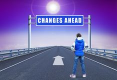 Little girl standing on a straight motorway leading to changes. Little girl standing on a straight motorway leading ahead to changes stock image