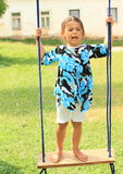 Little girl standing on a swing Royalty Free Stock Images