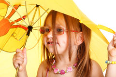 Little Girl standing with umbrella Stock Image