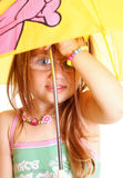 Little Girl standing with umbrella Royalty Free Stock Photography