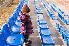 Little girl standing on a viewing stand Royalty Free Stock Image