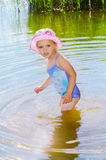 Little girl standing in the water. Stock Photography