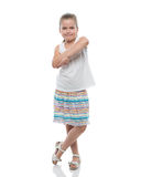 Little girl standing on white backdrop Stock Image