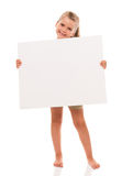 Little girl is standing on white background and holding white ca. I can hold this piece of cardboard where could be your advertisement or logo of your company Stock Images