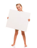 Little girl is standing on white background and holding white ca. I can hold this piece of cardboard where could be your advertisement or logo of your company Royalty Free Stock Image