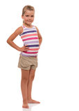 Little girl standing on white background. I'm small so far, but I'm learning to understand the sense of life Royalty Free Stock Images