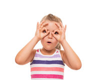 Little girl standing on white background and pretending that hol. It is possible to seen only with binoculars Stock Photo