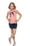 Little girl standing wiht hands on hips Royalty Free Stock Images