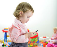 Little Girl Standing With Mobile Phone Stock Photography