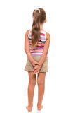 A little girl stands back, holding her hands behind her back. Today, I am not talking to you Stock Photos
