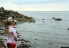 Little girl stands on the beach Royalty Free Stock Photography