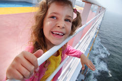 Little girl stands on board of ship Royalty Free Stock Photography