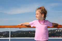 Little girl stands on deck of ship Royalty Free Stock Photo