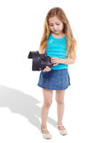 Little girl stands and looks upon mask Stock Image