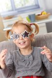 Little girl in star shaped glasses smiling Royalty Free Stock Image