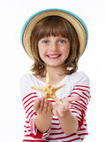 Little girl with a starfish Royalty Free Stock Image