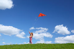 Little girl starts air serpent in sky Stock Photos