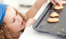 Little girl stealing cookies Stock Photography