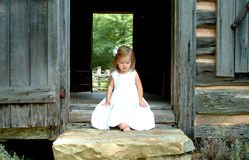 Little Girl on steps of Cabin Royalty Free Stock Photo