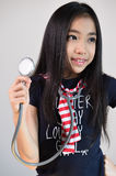 Little girl with stethoscope Stock Images