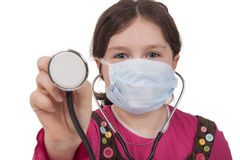 Little girl with stethoscope and surgical mask Stock Photography