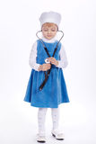 Little girl with stethoscope on white Royalty Free Stock Images