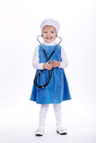 Little girl with stethoscope on white. Photo of little girl with stethoscope on white Stock Photography