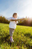 Little girl with a stick Royalty Free Stock Images