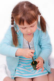 Little girl stirs the paint with a brush Royalty Free Stock Image