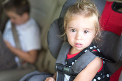 Little Girl Strapped Into A Childs Safety seat Stock Photography
