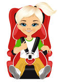 Little girl strapped to a car seat. Isolated on white background Stock Image