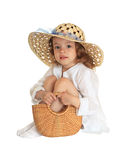 Little girl in a straw hat Royalty Free Stock Photos