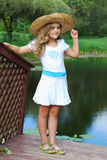The little girl in a straw hat Royalty Free Stock Photos
