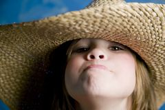 Little girl with a straw hat Royalty Free Stock Images