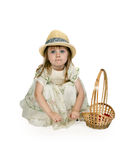 Little girl in a straw hat with a basket Stock Photography