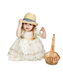 Little girl in a straw hat with a basket woven Stock Photo