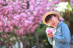 Little girl in a straw hat Stock Photos