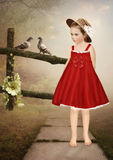 Little girl in a straw hat and pigeons Royalty Free Stock Images