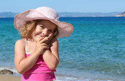 Little girl with straw hat portrait Stock Images