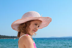 Little girl with straw hat portrait Stock Photos