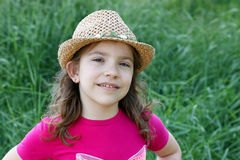 Little girl with straw hat Royalty Free Stock Image