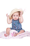 Little girl with straw hat. In studio on white background Stock Photography