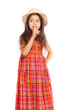 Little girl in straw showing silence sign Stock Photo