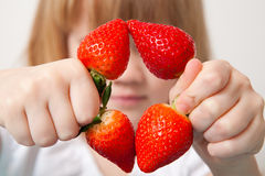 Little girl with strawberries Stock Image