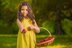 Little girl with strawberries Stock Images