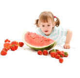 Little girl with strawberry and watermelon Royalty Free Stock Images