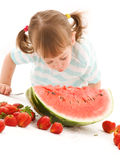 Little girl with strawberry and watermelon Stock Photography