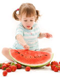 Little girl with strawberry and watermelon Royalty Free Stock Photos